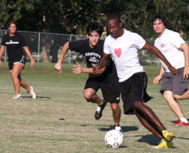 people playing intramural soccer