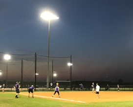 Photo of students playing intramural softball.