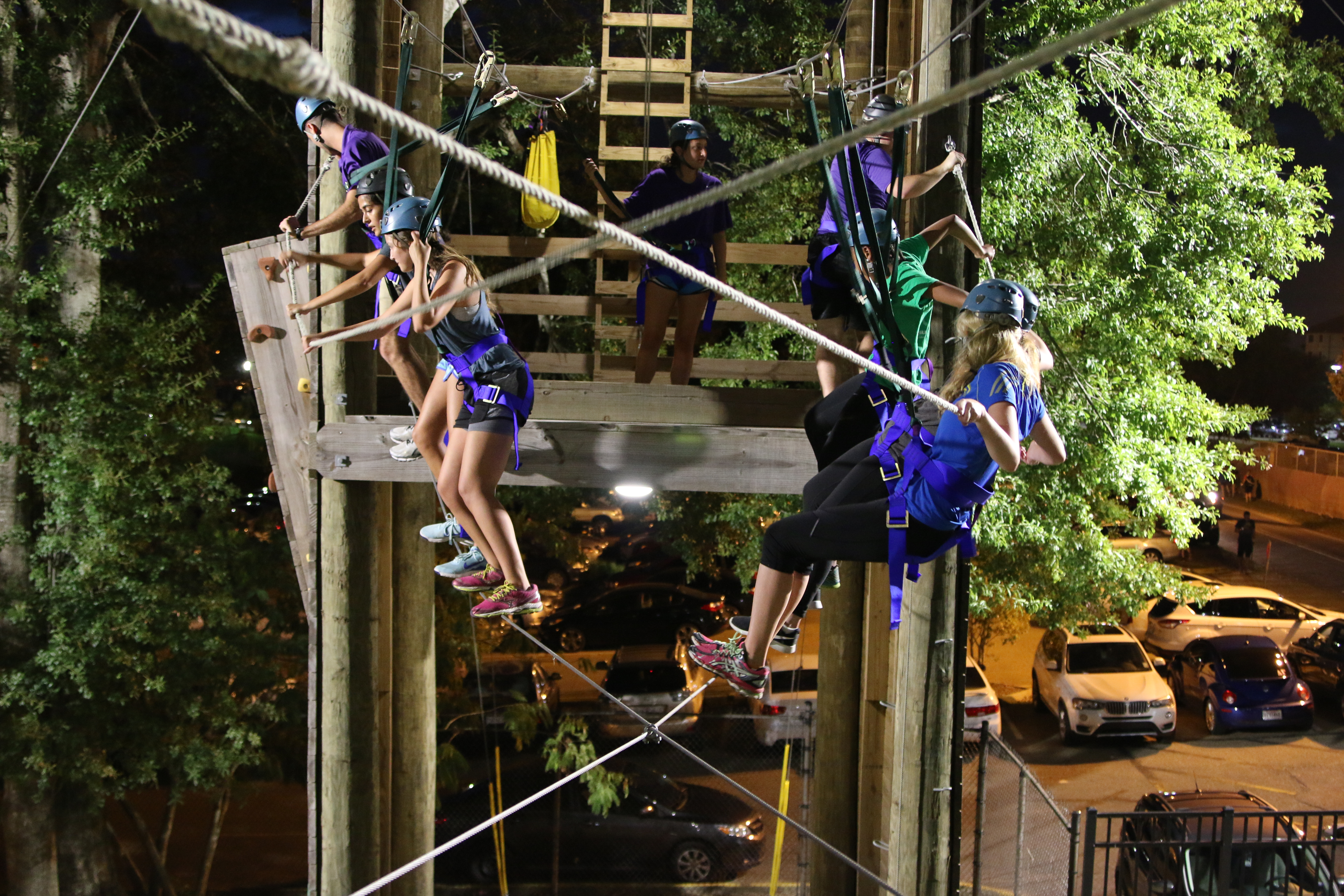 group on the challenge course at night