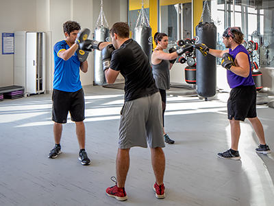 people at a groupx class in the boxing studio