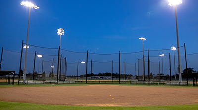 Photo of vacant baseball fields at night