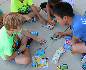 Tiger's Den Campers playing a card game