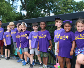 Group of Tiger's Den campers posing on bridge