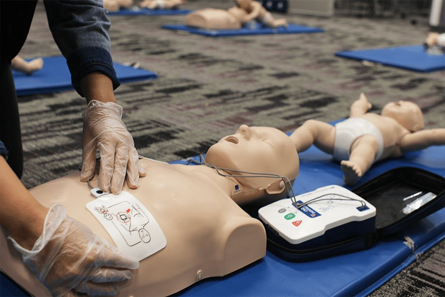 AED Defibrillator and CPR Mannequin