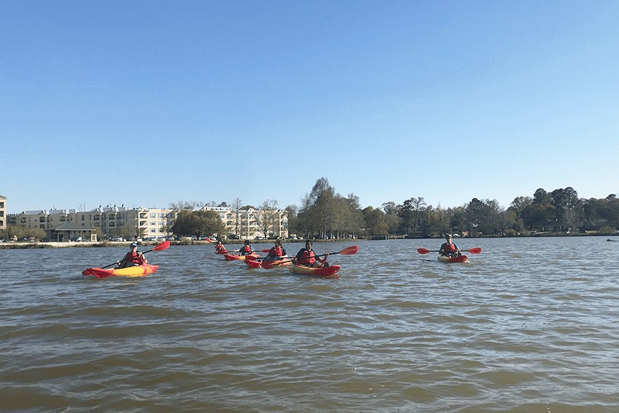 Group of 6 people kayaking on the LSU Lakes