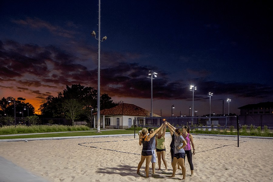 Volleyball team on sand volleyball courts.