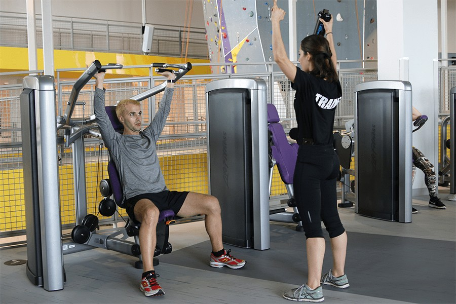 Personal Trainer and client exercising .