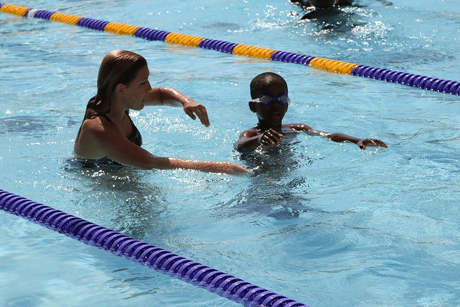 Female swim instructor and child swim student