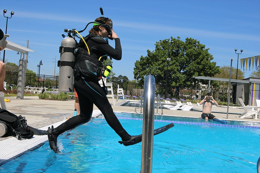 Female Scuba Student jumping in pool