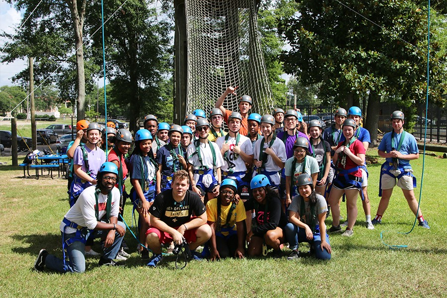 Large group in front of UREC Challenge Course.