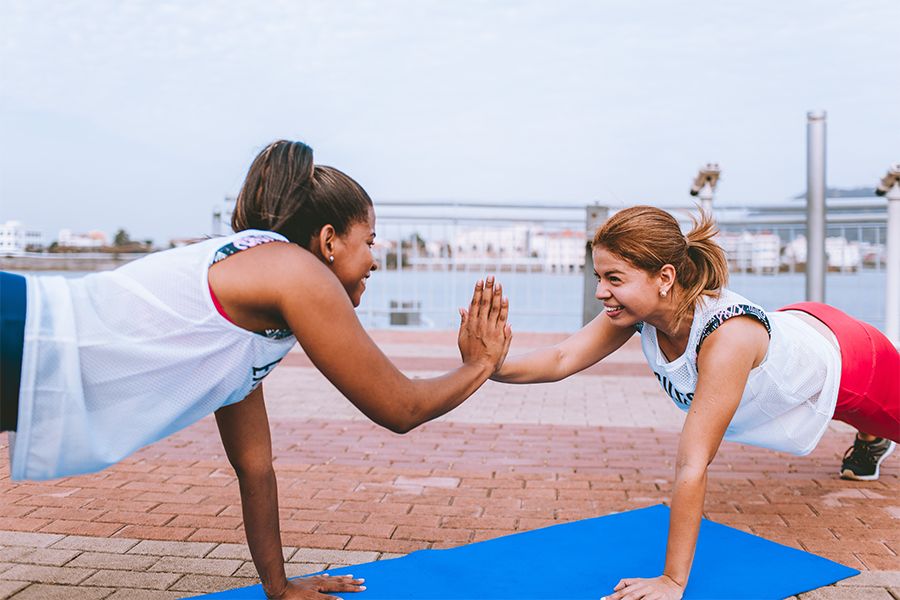 Two women doing a partner workout.