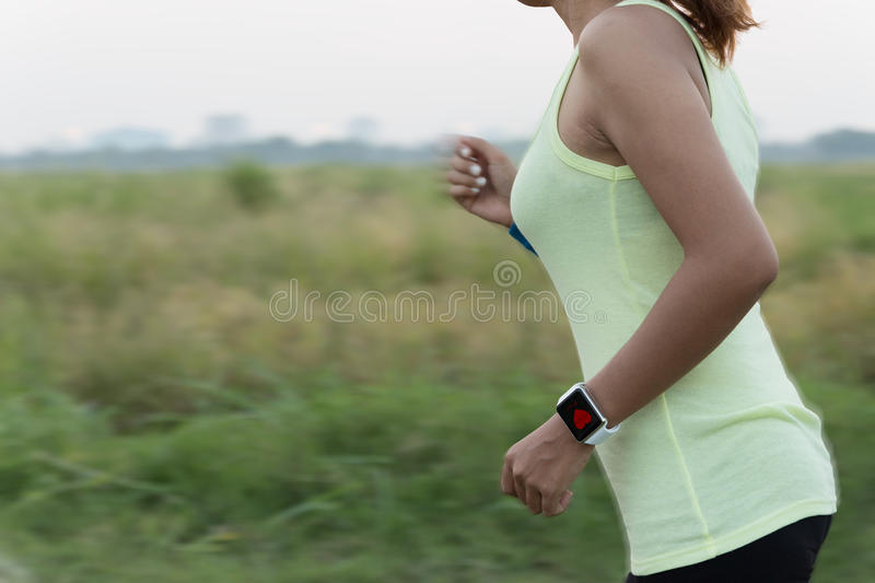 Stock photo of woman running outdoors.