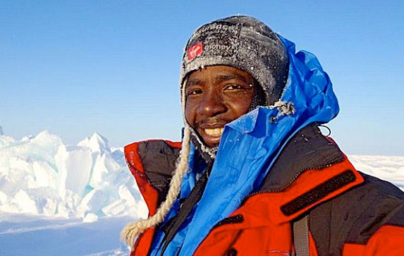 Picture of Sibusiso Vilane on a mountain summit.
