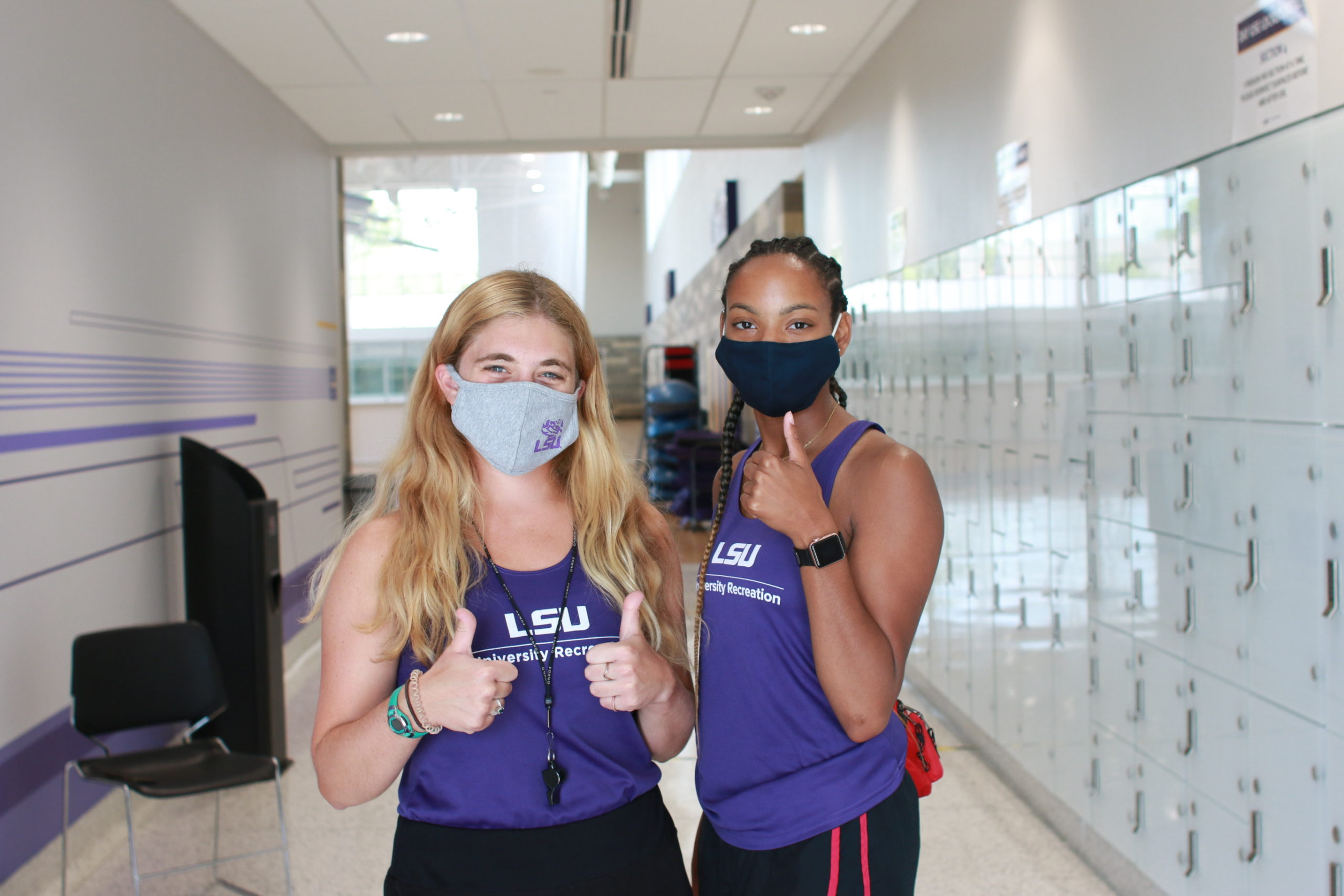 Two student employees giving a thumbs up!