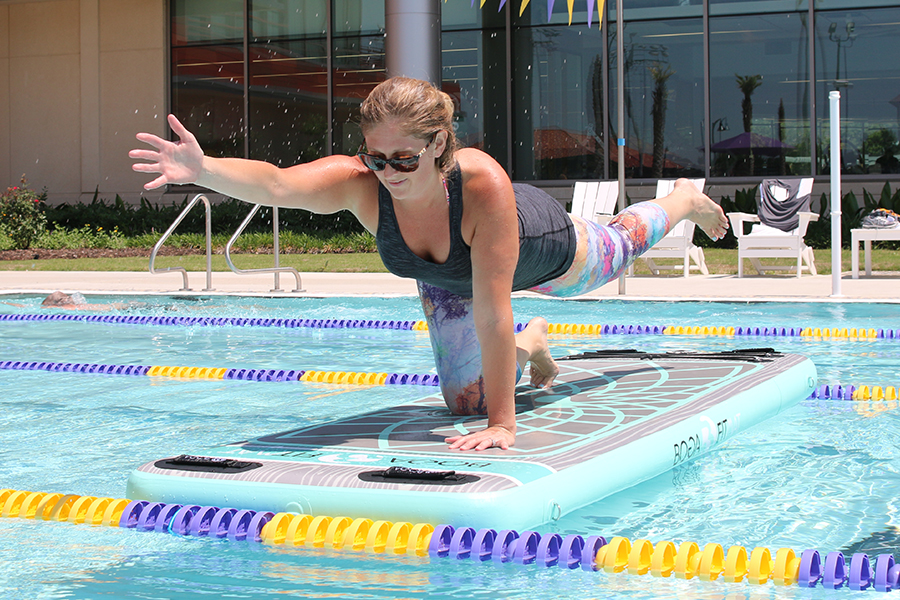 Patron in  the outdoor pool participating in the AquaZen class.