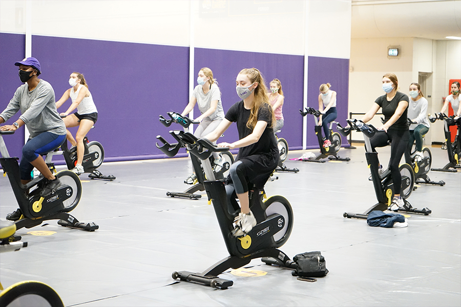 Patrons on bikes taking Cycle 45 class.